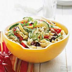 The fresh herbs, vegetables, and olives that characterize Greek cuisine are tossed with pasta in this sprightly salad recipe. Feta cheese gives it a tangy finish.