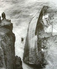 A crew member is rescued from a French ship which ran aground at Lands End, Cornwall. 12 men lost their lives. 1962.