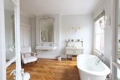 every bathroom should have a freestanding tub and a couch