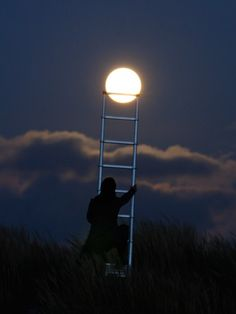 Wonderfully Imaginative Photos of People Posing with the Moon