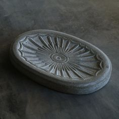 This cement sunburst soapdish is sure to add a splash of sunshine to your loved one's life. $19. Discover more lasting gifts at teakwarehouse.com.