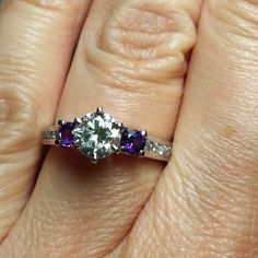 My engagement ring:  my mom's diamond from when she and my dad got engaged 48 years ago, which I designed into a custom ring with two amethyst accent stones. I love it so much!