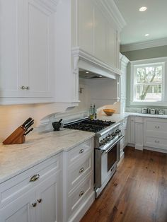 Updated Appliances: Stainless steel appliances, like this stove range, add to the overall traditional feel of this renovated kitchen space. From HGTVRemodels.com