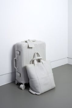 Ryan Gander MY HEAD ON YOUR BELLY 2013 Marble resin 39 x 36 x 56 cm — A marble sculpture of two pieces of luggage that carry the essential belongings of the artist and accompany him whenever he travels.
