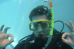 Photo about A scuba diver has an underwater adventure while learning to dive under water. Image of diving, clown, dives - 2707963