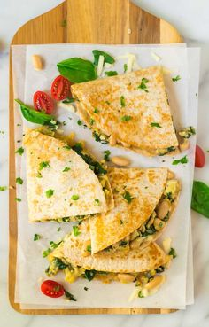 Breakfast Quesadilla with eggs, spinach, cheese, and beans. Freezer friendly and filling, these are easy to make ahead for fast, healthy meals!