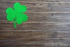 Green shamrock on a wooden background.Patrick`s Day background. Symbol of Ir , Wooden Background, Logo Ideas, St Patrick, Symbols, Stock Photos, Day, Green, Image, Glyphs