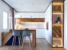 A clean-lined contemporary kitchen is warmed by wood inside the white cabinetry. Kitchen Room Design, Modern Kitchen Design, Kitchen Interior, Kitchen Decor, Kitchen Island Table, Contemporary Apartment, Apartment Interior Design, Cuisines Design, Cabinet Design