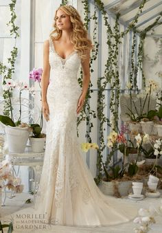 Wedding Dresses and Wedding Gowns by Morilee featuring Crystal Beading on Laser Cut, Embroidered Appliques onto the Net Gown Over Soft Satin Colors Available: White/Silver, Ivory/Silver, Light Gold/Silver.