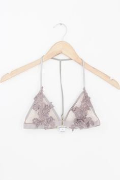Details Shipping • 100% Polyester • Lace overlay bralette, T-strap back, front hook and eye closure • Hand Wash • Line dry • Imported Free domestic shipping on