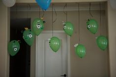 Angry Birds party ideas - hang green piggy balloons from the ceiling and have slingshots and soft balls/birds available to shoot at them