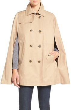 Free shipping and returns on CeCe 'Lily' Trench Cape at Nordstrom.com. The timeless trench takes new shape as a double-breasted cotton-blend cape sporting a single gunflap and faux-horn buttons. A grosgrain ribbon, crowned with a pert bow, runs down the center back to feminize the utilitarian style.