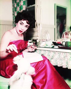 Elizabeth Taylor - Sitting at vanity table with puppy Another fab pic for my closet
