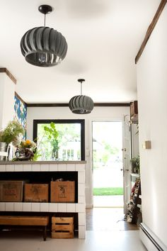 DIY pendant light from old exhaust fans. Love those antique boxes, too.