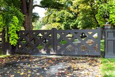 A transitional-style driveway gate. The diamond trellis wood is painted a very dark gray. We wrapped the gate posts with matching wood. Driveway Entrance Landscaping, Driveway Gate, Bedford Hills, Front Yard Fence, Pool Fence, Gate Post, Wood Trellis, Entrance Gates, Entrance Ideas