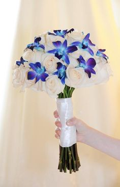 Bouquet with blue flowers...I love the way this is wrapped! @Emily Schoenfeld Schoenfeld Elizabeth-Writer
