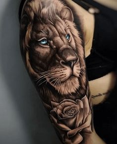 lion-head-with-blue-eyes-rose-underneath-shoulder-tattoo-lion-sleeve-tattoo-on-w. - lion-head-with-blue-eyes-rose-underneath-shoulder-tattoo-lion-sleeve-tattoo-on-woman-wearing-black- - Lion Sleeve, Lion Tattoo Sleeves, Best Sleeve Tattoos, Sleeve Tattoos For Women, Tattoo Sleeve Designs, Tattoo Sleves, Animal Sleeve Tattoo, Animal Tattoos, Lion Head Tattoos