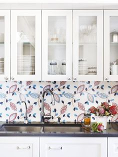 Amp up a bland spot behind the sink with a vivid tile or a bright fabric under tempered glass (like the one shown here). Frequent watering encouraged.