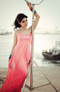 Asin Thottumkal:  I LOVE this dress, her bangles and her hair and makeup.  I just don't love her.  Is there a movie out there that will make me like her more? Suggestions?