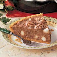 Chocolate Mallow Pie Recipe -To complete a meal, I often serve this not-too-sweet pie. This rich and cream dessert is so easy to assemble. To save time, I often prepare and freeze a graham cracker pie crust so all I have to do is thaw and fill it.—Glenda Parsonage, Maple Creek, Saskatchewan