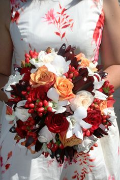 red beach wedding bouquets | ... red leucodendrons, red hypericum berries and white singapore orchids