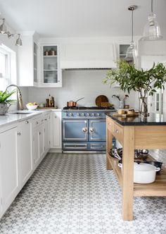 Park and Oak Design kitchen renovation. I like the patterned floor and mix of open shelving + glass doors. Would want a grey lower cabinet...