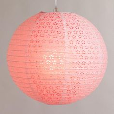 These might fit in with a new, warm, light walled color theme playing off the Orchid. WorldMarket.com: Coral Pink Eyelet Paper Lantern