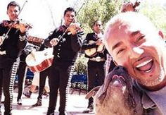 Cesar Millan with his pit bull Junior and a Mariachi band