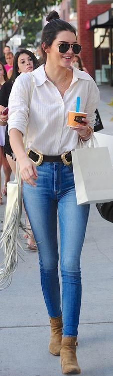 Kendall Jenner: Jeans – AG  Shirt – Statesside  Bracelet – Cartier  Belt – B-Low  Shoes and sunglasses – Saint Laurent
