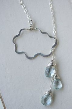 It looks like the cloud is just a simple wire wrap hammered flat. I wonder if I could pull this off.
