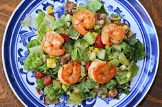 Summer shrimp salad with avocado, tomato, cucumber and corn