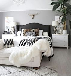 Future Bedroom Ideas: Neutral Bedroom With Crystal Chandelier, Button  Tufted Chaise, Black And White Accents And Leather Studded Wingback Bed