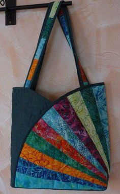 Fan quilted tulip tote bag. No tutorial here, just a pic, but I love the idea.