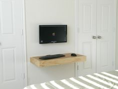 Imac Custom House Modern Small Furniture With Floating Wooden Board Table And Lcd Tv Wall Mount On The White Wall Beside White Doors of Minimalist Design Mac Computer Table Ideas  from Furniture Ideas