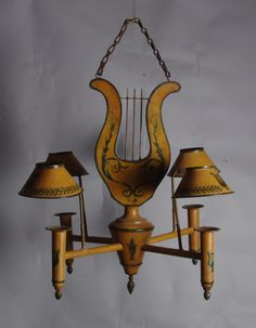 Regency style lyre-shaped painted tole chandelier to a design by the interior designer Dudley Poplack who helped furnish Highgrove house for the Prince of Wales. English, second half of the 20th century.