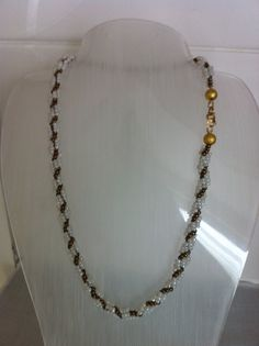 Necklace. Brown & cream seed beads, with gold findings.
