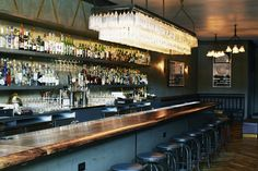 First Course: Brass Tacks is SF's New Industrial-Chic Watering Hole   California Home + Design - great lighting fixture with bottles