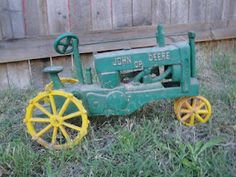 Awesome! Told Eli this can't just be bought at the store! Vintage John Deere Toy