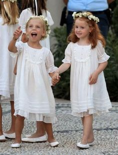 Pinafore dresses + flats + floral crowns=a comfy and classic #flowergirl ensemble. We love it! #weddinginspo