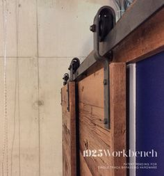 Our single track bypassing hardware is patent pending. Used here with reclaimed wood doors, also handmade by 1925Workbench.