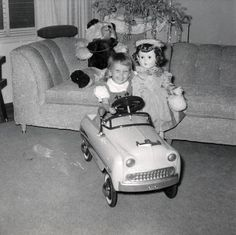 Vintage Photo of a little girl with her toys.
