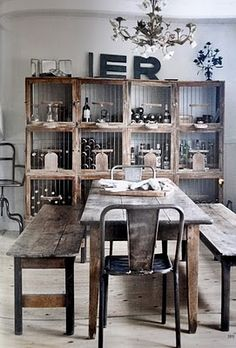 Rustic dining table. Use matching benches, metal chairs. Good possibility.  Back Wall Shelving. Possible décor interest or Retail Sales Area