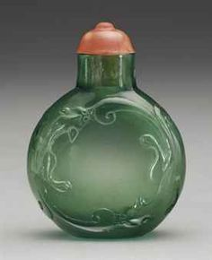 A RARE AND FINELY CARVED TRANSPARENT GREEN GLASS SNUFF BOTTLE  ATTRIBUTED TO THE IMPERIAL GLASSWORKS, BEIJING, 1740-1820
