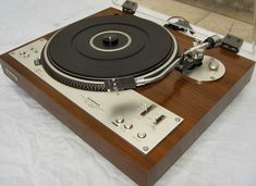 New goal is to find a sweet Pioneer Turntable with solid wood plinth.