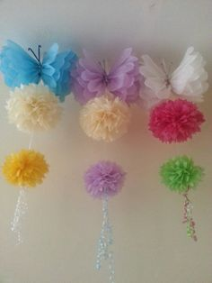 All pom poms are sent Pre- assembled but not in bloom. These delightful Pom poms are the perfect decoration to brighten up any room& to be admired by everyone. These pom poms are all handmade. All pom poms you see in my photos are made by Partydecoqueen. Butterfly Party, Butterfly Decorations, Birthday Decorations, Baby Shower Decorations, Paper Butterflies, Tissue Paper Flowers, Hang From Ceiling Decor, Jungle Theme Birthday, Pom Pom Baby