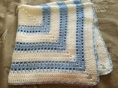 Handmade crocheted Baby Shower/Newborn Gift baby blanket. I only use quality yarn which feels very soft to the touch. Machine washable and dryer safe. Wonderful heirloom which can be passed from generation to generation for either a boy or girl. Comes from a smoke free home. Feel free to visit my shop for other crochet baby items http://www.etsy.com/shop/jesjaymat Item usually ships within 72 hours. Delivery ConfirMation BLANKET ALSO AVAILABLE IN PINK