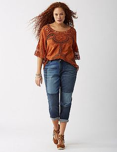 The stretch denim capri made for weekends (and any other time, really). Mixed washes and whiskering. Rolled cuffs. 5-pocket styling. Button & zip fly closure. Belt loops. lanebryant.com