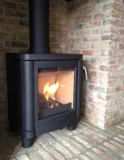 Contura 51L in brick fireplace with brick hearth