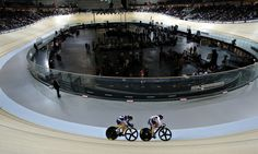 Britain's Vicky Williamson and France's Sandie Clair compete in a sprint event to mark the opening of the new velodrome in Paris. Photograph...
