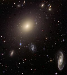This image from NASA/ESA Hubble Space Telescope shows the diverse collection of galaxies in the cluster Abell S0740 that is over 450 million light-years away in the direction of the constellation Centaurus.